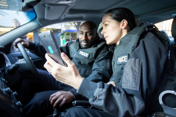 Police with Smartphone from EE - image courtesy of EE